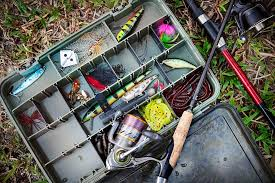 looking down onto a tacklebox full of fishing gear